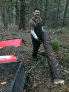 Luis gathering firewood